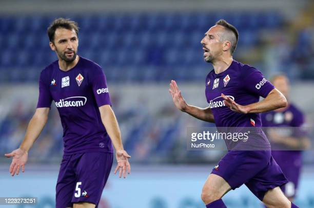 Franck Ribery of Fiorentina celebrates with Milan Badelj after scoring the goal of 01 during the football Serie A match SS Lazio v ACF Fiorentina at...