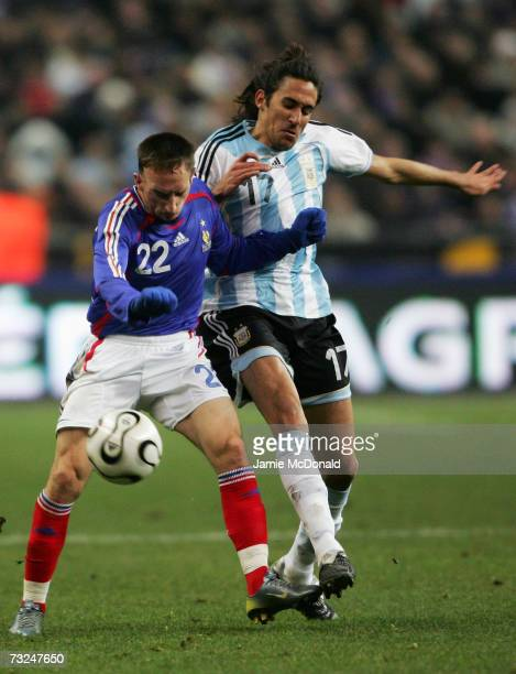 Franck Ribery of France battles with Jonas Gutierrez of Argentina during the International friendly match between France and Argentina at the Stade...