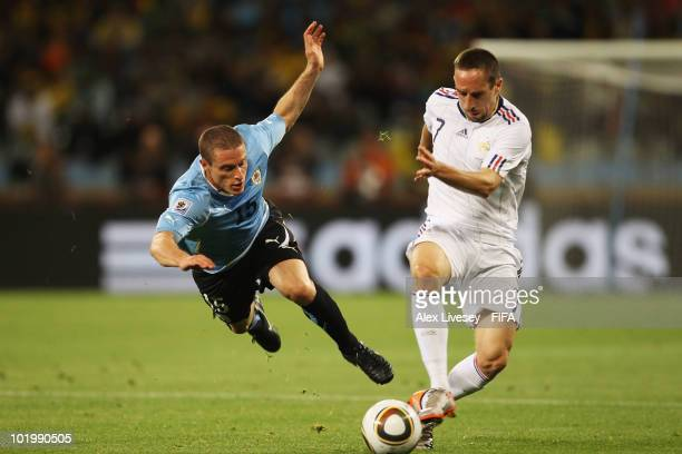 Franck Ribery of France is challenged by Diego Perez of Uruguay during the 2010 FIFA World Cup South Africa Group A match between Uruguay and France...