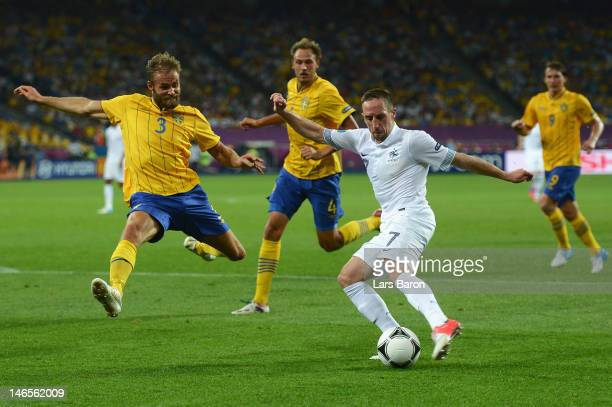 Franck Ribery of France is challenged by Olof Mellberg of Sweden during the UEFA EURO 2012 group D match between Sweden and France at The Olympic...