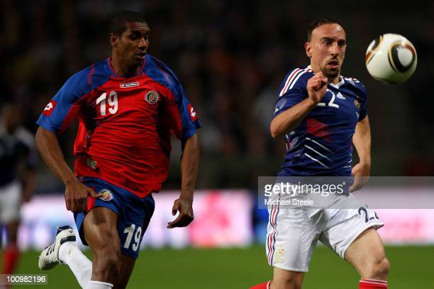Franck Ribery of France is chased down by Roy Myrie during the France v Costa Rica International Friendly match at Stade Felix Bollaert on May 26,...