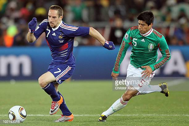 Franck Ribery of France is followed by Ricardo Osorio of Mexico during the 2010 FIFA World Cup South Africa Group A match between France and Mexico...