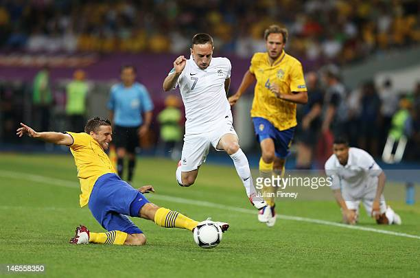 Franck Ribery of France is tackled by Anders Svensson of Sweden during the UEFA EURO 2012 group D match between Sweden and France at The Olympic...