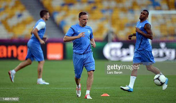 Franck Ribery of France runs with the ball during a UEFA EURO 2012 training session at the Olympic Stadium on June 19, 2012 in Kiev, Ukraine.