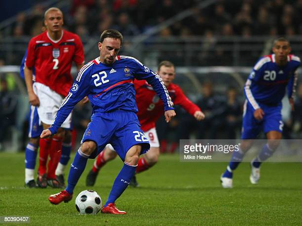 Franck Ribery of France scores their first goal from the penalty spot during the International Friendly match between France and England at the Stade...
