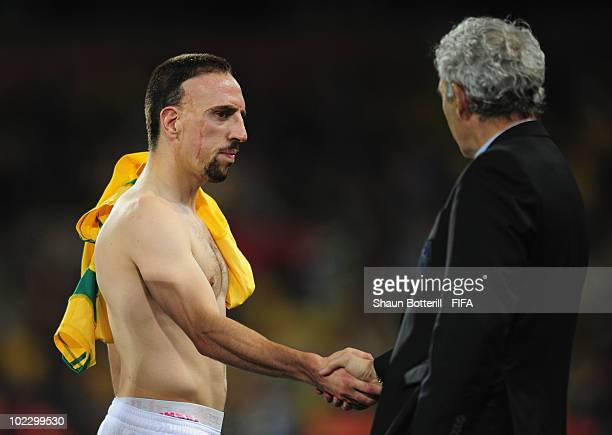 Franck Ribery of France shakes hands with Raymond Domenech head coach of France after the 2010 FIFA World Cup South Africa Group A match between...