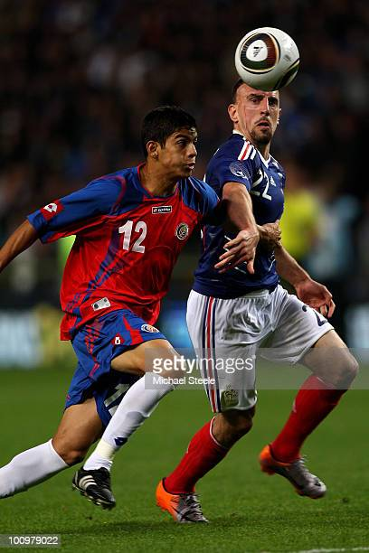 Franck Ribery of France tussles for the ball with Cristian Gamboa during the France v Costa Rica International Friendly match at Stade Felix Bollaert...