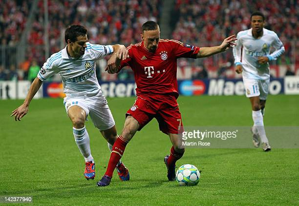 Franck Ribery of Muenchen and Cesar Azpilicueta of Marseille battle for the ball during the UEFA Champions League quarterfinal second leg match at...