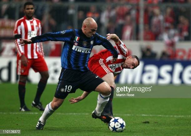 Franck Ribery of Muenchen and Esteban Cambiasso of Milan battle for the ball during the UEFA Champions League round of 16 second leg match between FC...