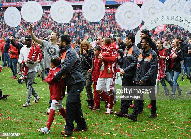 Franck Ribery of Muenchen and his family is guided to the exit surrounded by fans after the Bundesliga match between FC Bayern Muenchen and Hannover...