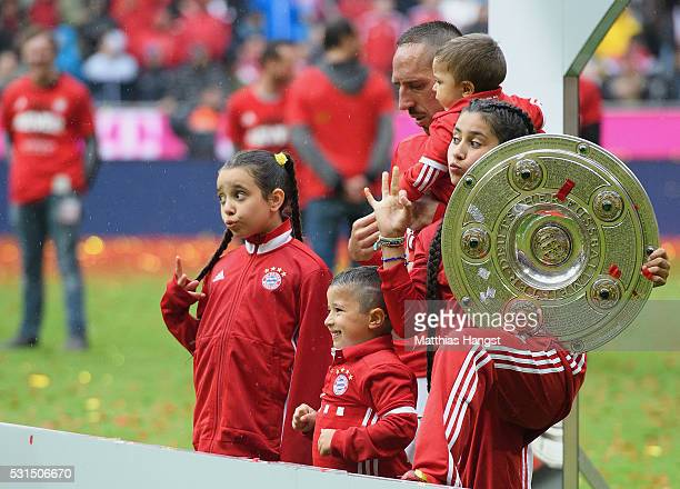 Franck Ribery of Muenchen and his kids celebrate with the Meisterschalfe after the Bundesliga match between FC Bayern Muenchen and Hannover 96 at...