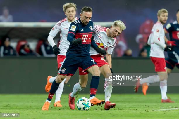 Franck Ribery of Muenchen and Kevin Kampl of Leipzig battle for the ball during the Bundesliga match between RB Leipzig and FC Bayern Muenchen at Red...