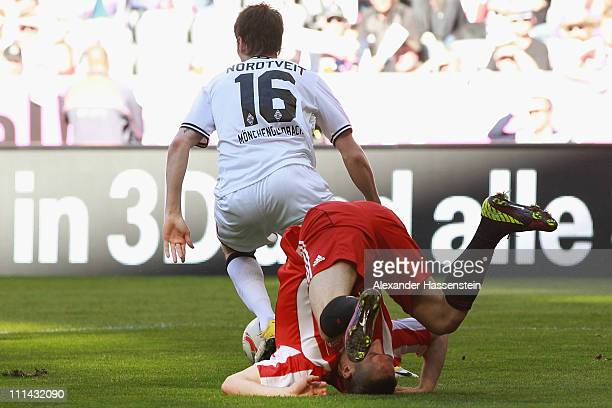 Franck Ribery of Muenchen battles for the ball with Havard Nordtveit of Gladbach during the Bundesliga match between FC Bayern Muenchen and Borussia...