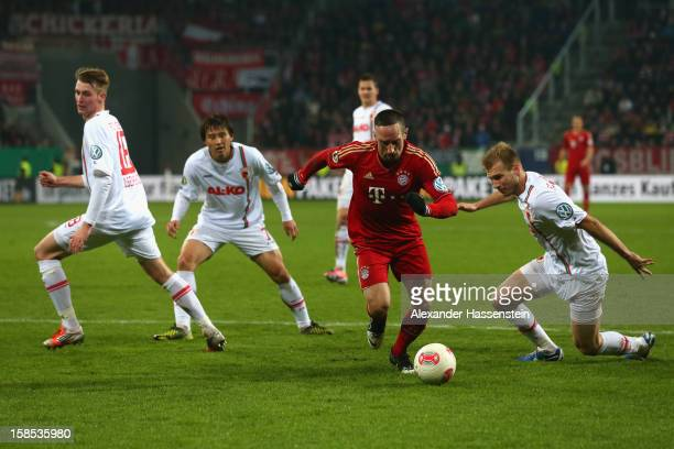 Franck Ribery of Muenchen battles for the ball with Ragnar Klavan of Augsburg and his team mates JaCheol Koo and JanIngwer CallsenBracker during the...