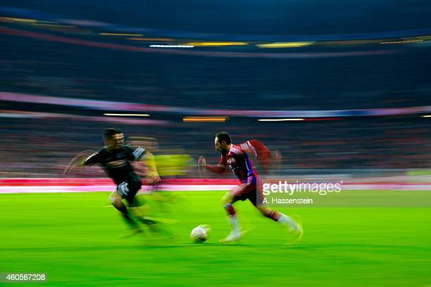 Franck Ribery of Muenchen battles for the ball with Sascha Riether of Freiburg during the Bundesliga match between FC Bayern Muenchen and SC Freiburg...