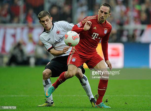 Franck Ribery of Muenchen battles for the ball with Sebastian Jung of Frankfurt during the Bundesliga match between FC Bayern Muenchen and Eintracht...
