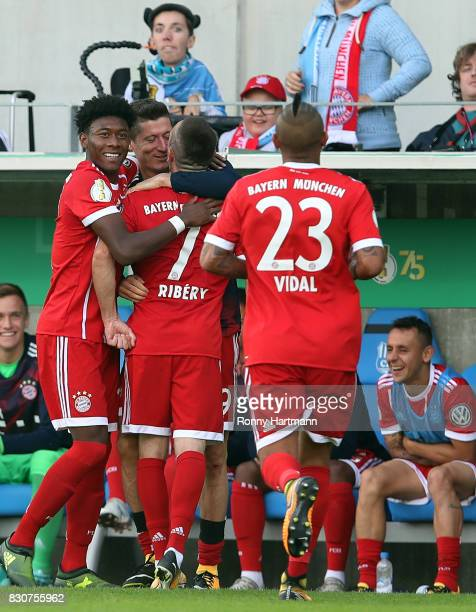 Franck Ribery of Muenchen celebrates after scoring his team's fourth goal with David Alaba Robert Lewandowski and Arturo Vidal of Muenchen during the...