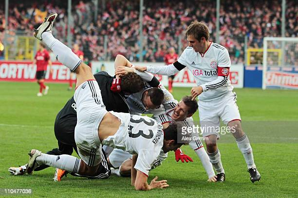 Franck Ribery of Muenchen celebrates his team's second goal with team mates Mario Gomez Bastian Schweinsteiger and Philipp Lahm during the Bundesliga...