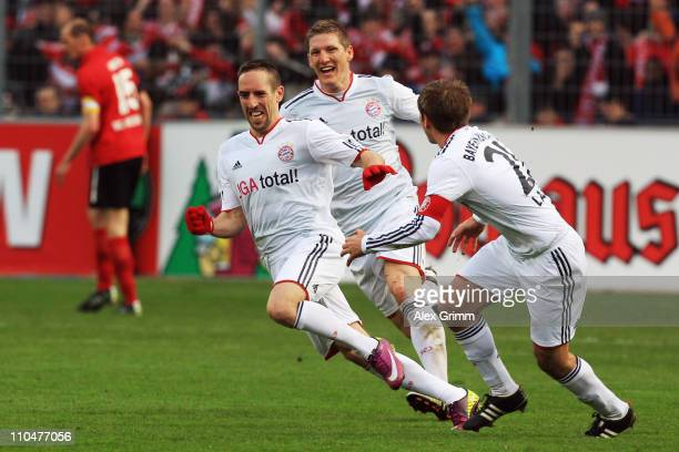 Franck Ribery of Muenchen celebrates his team's second goal with team mates Bastian Schweinsteiger and Philipp Lahm during the Bundesliga match...