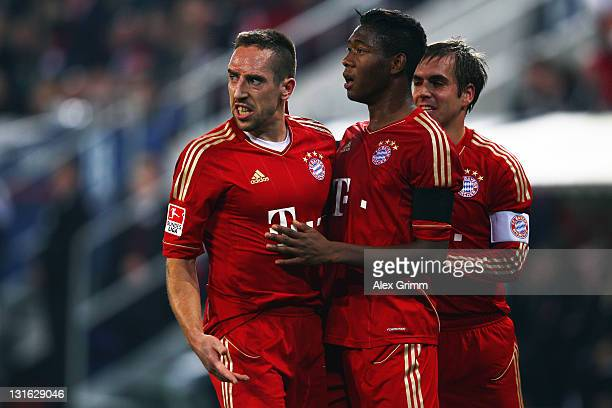 Franck Ribery of Muenchen celebrates his team's second goal with team mates David Alaba and Philipp Lahm during the Bundesliga match between FC...