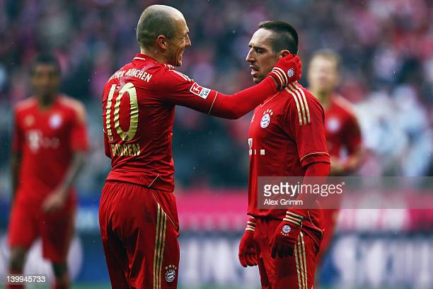 Franck Ribery of Muenchen celebrates his team's second goal with team mate Arjen Robben during the Bundesliga match between FC Bayern Muenchen and FC...
