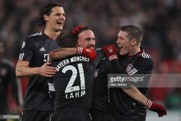 Franck Ribery of Muenchen celebrates his team's sixth goal with team mates Daniel van Buyten Philipp Lahm and Bastian Schweinsteiger during the DFB...