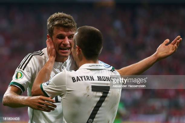 Franck Ribery of Muenchen celebrates scoring the 4rd team goal with his team mate Thomas Mueller during the DFB Cup match between FC Bayern Muenchen...