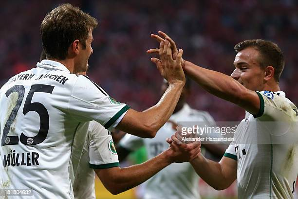 Franck Ribery of Muenchen celebrates scoring the 4rd team goal with his team mate Xherdan Shaquiri during the DFB Cup match between FC Bayern...