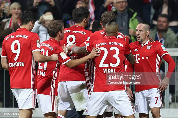 Franck Ribery of Muenchen celebrates scoring the opening goal with his team mates during the Bundesliga match between Bayern Muenchen and Hertha BSC...