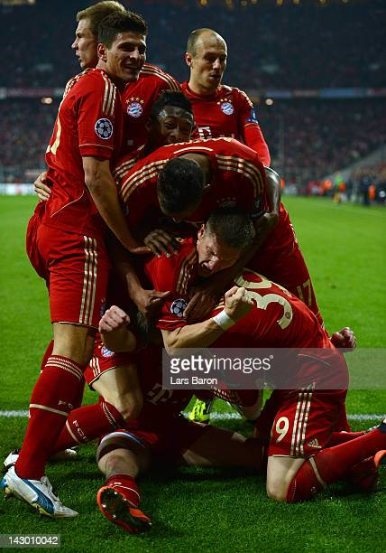 Franck Ribery of Muenchen celebrates with Bastian Schweinsteiger and other team mates after scoring his teams first goal during the UEFA Champoins...
