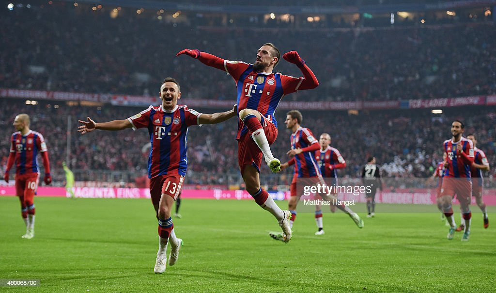 Franck Ribery of Muenchen celebrates with his team-mates after scoring his team's first goal during the Bundesliga match between FC Bayern Muenchen and Bayer 04 Leverkusen at Allianz Arena on December 6, 2014 in Munich, Germany.