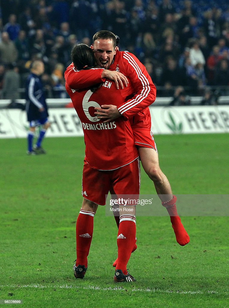 Franck Ribery of Muenchen celebrates with team mate Martin Demichelis #6 after the Bundesliga match between FC Schalke 04 and FC Bayern Muenchen at the Veltins Arena April 3, 2010 in Gelsenkirchen, Germany.