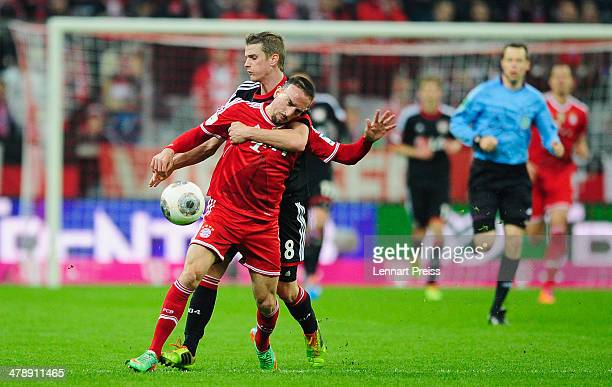 Franck Ribery of Muenchen challenges Lars Bender of Leverkusen during the Bundesliga match between FC Bayern Muenchen and Bayer 04 Leverkusen at...