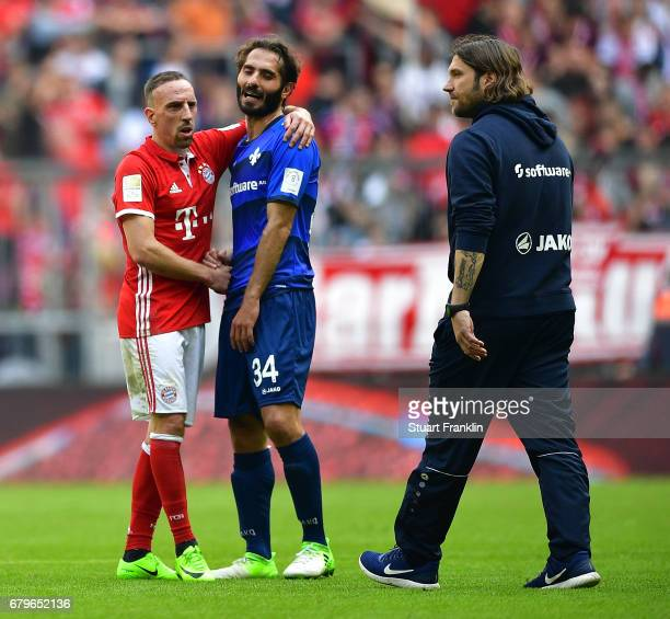 Franck Ribery of Muenchen consoles Hamit Altintop of Dramstadt as Torsten Frings, head coach of Darmstadt looks on after the Bundesliga match between...