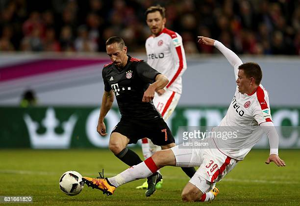 Franck Ribery of Muenchen is challenged by Alexander Madlung of Duesseldorf during the Telekom Cup 2017 match between Fortuna Duesseldorf and Bayern...