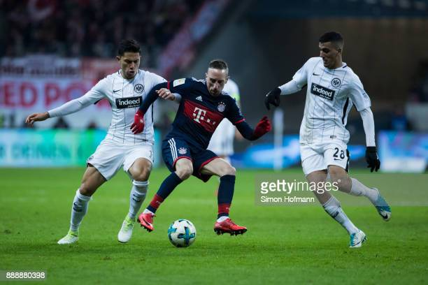 Franck Ribery of Muenchen is challenged by Aymen Barkok and Carlos Salcedo of Frankfurt during the Bundesliga match between Eintracht Frankfurt and...
