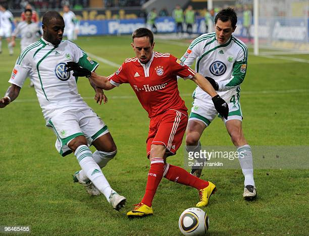 Franck Ribery of Muenchen is challenged by Grafite and Marcel Schaefer of Wolfsburg during the Bundesliga match between Vfl Wolfsburg and FC Bayern...