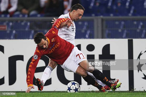 Franck Ribery of Muenchen is challenged by Marco Cassetti of Roma during the UEFA Champions League group E match between AS Roma and FC Bayern...