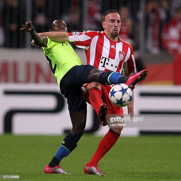 Franck Ribery of Muenchen is challenged by Samuel Inkoom of Basel during the UEFA Champions League group E match between FC Bayern Muenchen and FC...