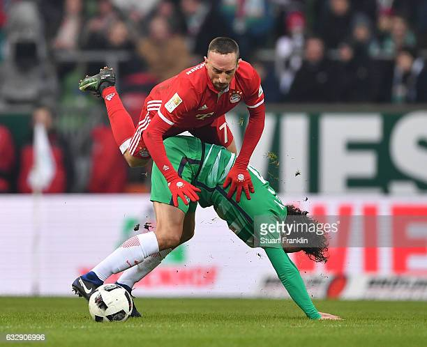 Franck Ribery of Muenchen is challenged by Thomas Delaney of Bremen during the Bundesliga match between Werder Bremen and Bayern Muenchen at...