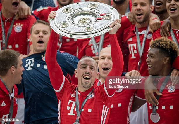 Franck Ribery of Muenchen lifts the Meisterschale as players and staffs celebrate the Bundesliga championship after the Bundesliga match between FC...