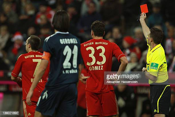 Franck Ribery of Muenchen receives the Red card from Referee Guido Winkmann during the Bundesliga match between FC Bayern Muenchen and 1. FC Koeln at...