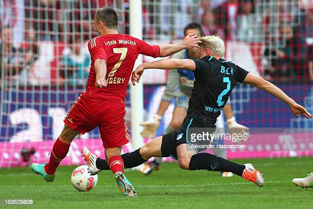 Franck Ribery of Muenchen scortes the first team goal against Adreas Beck of Hoffenheim and keeper Koen Casteels during the Bundesliga match between...