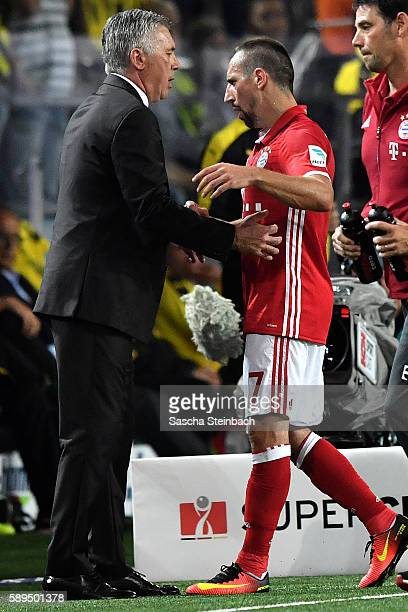 Franck Ribery of Muenchen shakes hands with head coach Carlo Ancelotti after being substituted during the DFL Supercup 2016 match between Borussia...