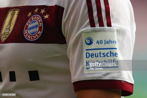 Franck Ribery of Muenchen wears a jersey with a badge of the German Cancer Foundation during the Bundesliga match between Eintracht Frankfurt and FC...