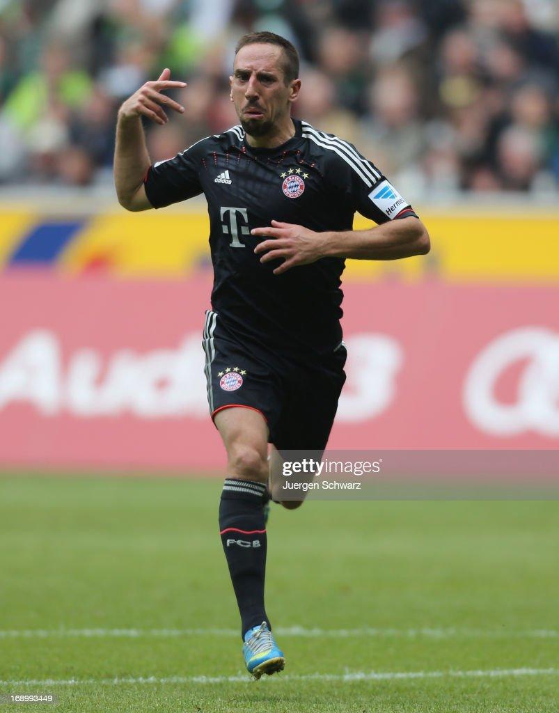 Franck Ribery of Munich celebrates during the Bundesliga match between Borussia Moenchengladbach and Bayern Muenchen at Borussia Park Stadium on May 18, 2013 in Moenchengladbach, Germany.