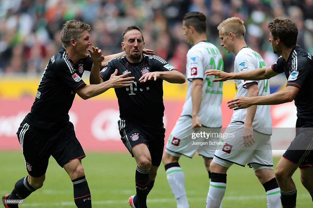 Franck Ribery of Munich (C) celebrates with Bastian Schweinsteiger (L) and Thomas Mueller after scoring during the Bundesliga match between Borussia Moenchengladbach and Bayern Muenchen at Borussia Park Stadium on May 18, 2013 in Moenchengladbach, Germany.