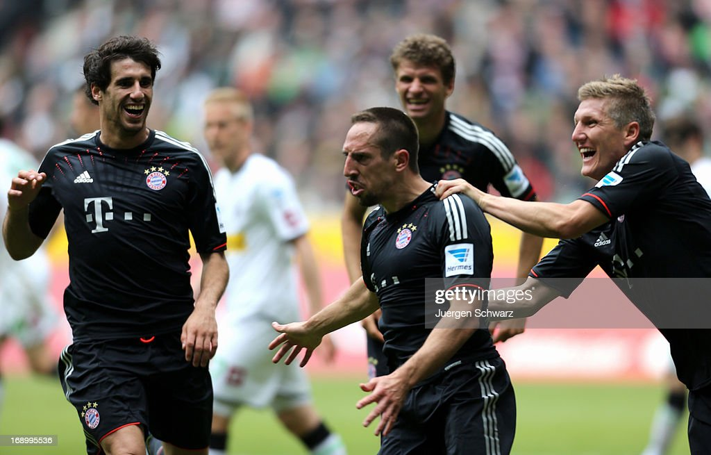 Franck Ribery of Munich (C) celebrates with Bastian Schweinsteiger (R), Thomas Mueller (back) and Javier Martinez after scoring during the Bundesliga match between Borussia Moenchengladbach and Bayern Muenchen at Borussia Park Stadium on May 18, 2013 in Moenchengladbach, Germany.