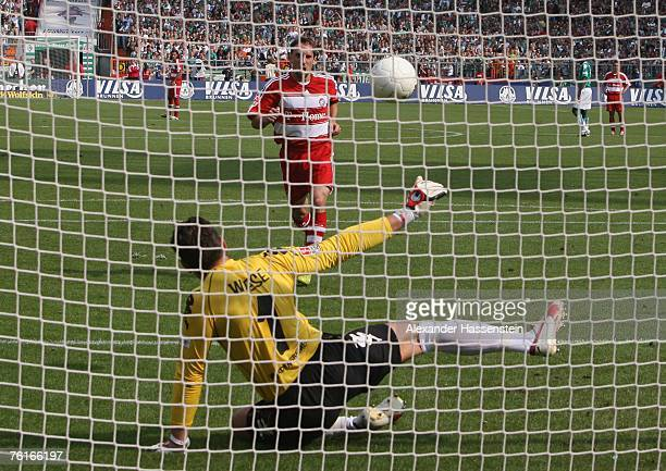 Franck Ribery of Munich scores the first goal through a penalty against goalkeeper Tim Wiese of Bremen during the Bundesliga match between Werder...
