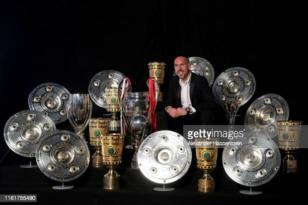 Franck Ribery poses for a picture with all his trophys won with the FC Bayern Muenchen team during an event at FCB Erlebniswelt on May 28 2019 in...